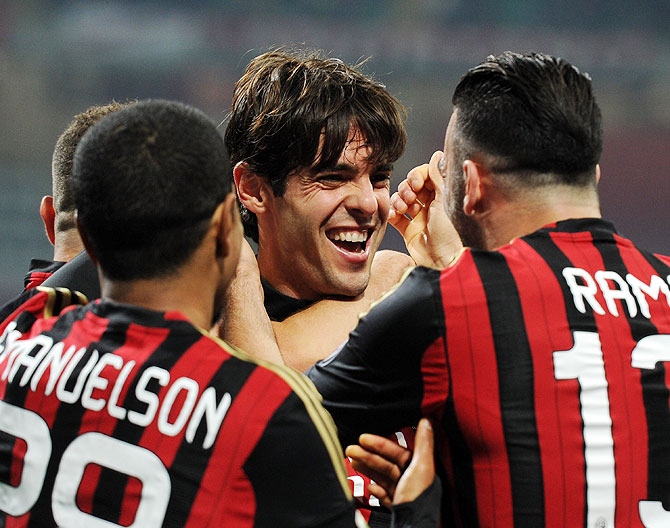 Kaka of AC Milan (C) celebrates scoring the third goal during the Serie A match between AC Milan and AC Chievo Verona at San Siro Stadium in Milan on Saturday