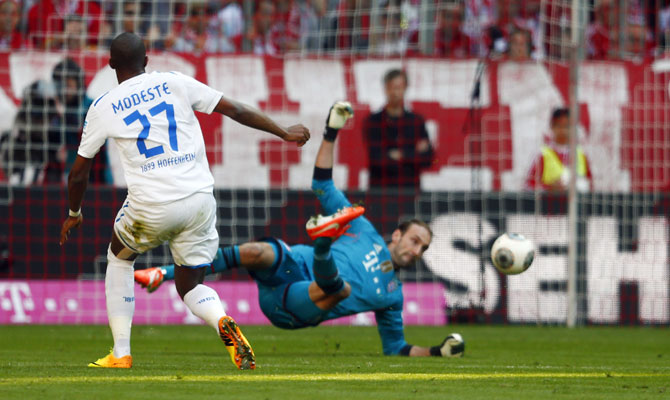 Hoffenheim's Anthony Modeste scores a goal past Bayern Munich's goalkeeper Tom Starke during their Bundesliga match in Munich on Saturday