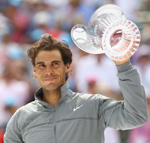 Rafael Nadal of Spain holds the runners-up trophy after losing to Novak Djokovic of Serbia in the final in Miami