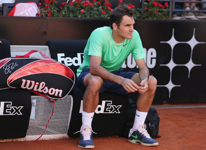 Roger Federer of Switzerland shows his dejection after a straight sets defeat