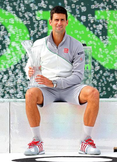 Novak Djokovic of Serbia holds the winner's trophy after winning the Sony Open at Crandon Park Tennis Center