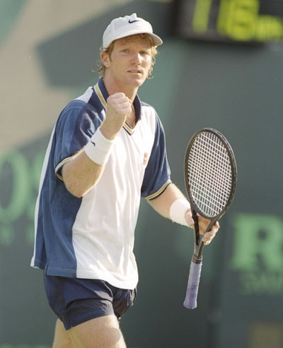 Jim Courier of the United States celebrates winning a match