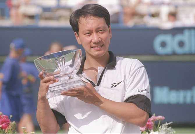 Michael Chang of the United States poses with the trophy during the Newsweek Cup in Indian Wells