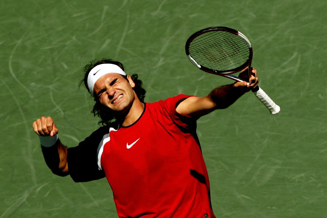 Roger Federer of Switzerland celebrates after winning