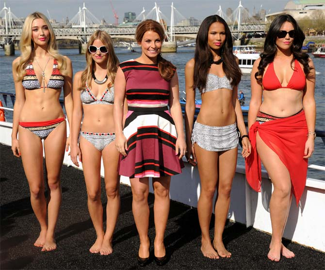 Coleen Rooney (center) attends a photocall to launch the her Fashion and Swimwear SS14 collection for Littlewoods.com