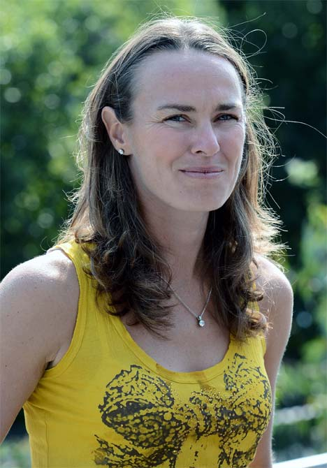 Martina Hingis of Switzerland speaks to the media