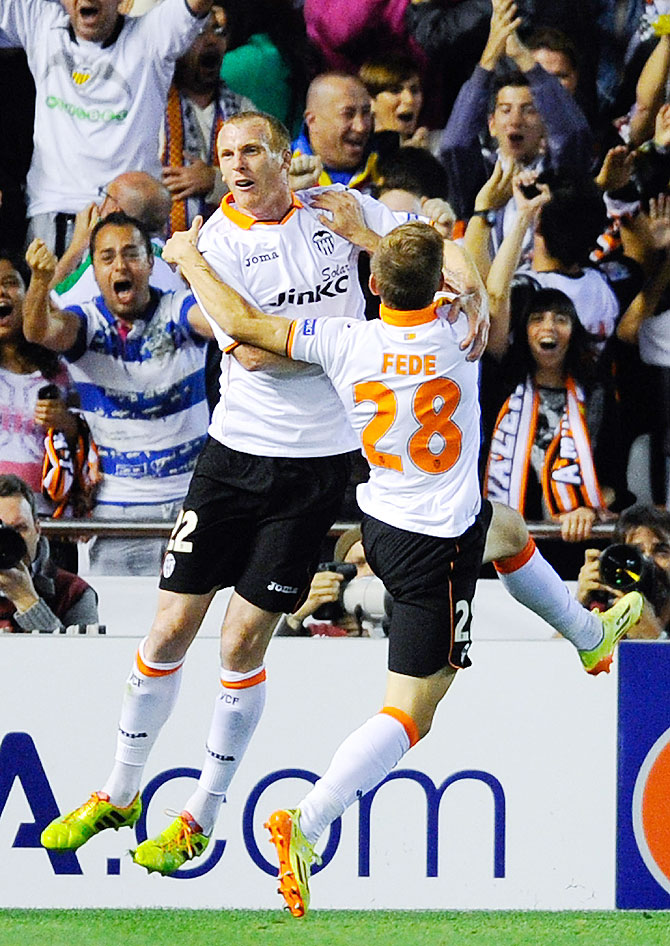 Jeremy Mathieu (left) of Valencia celebrates with teammates after scoring against Sevilla on Thursday