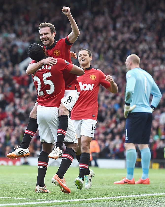 Juan Mata of Manchester United celebrates scoring against Norwich City at Old Trafford