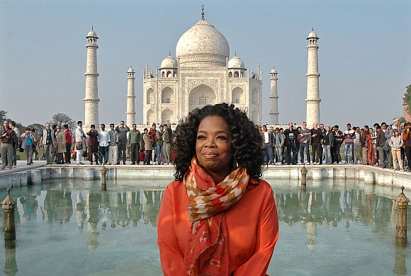 Oprah Winfrey poses for pictures in front of the historic Taj Mahal during her visit to Agra