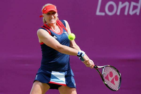 Elena Baltacha of Great Britain returns a shot against Agnes Szavay of Hungary during the women's singles match on Day 1 of the London 2012 Olympic Games