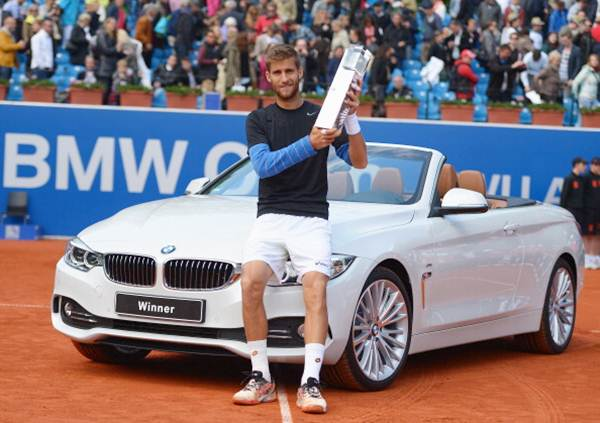 Martin Klizan of Slovakia poses with the trophy after winning the BMW Open final against Fabio Fognini of Italy in Munich, Germany