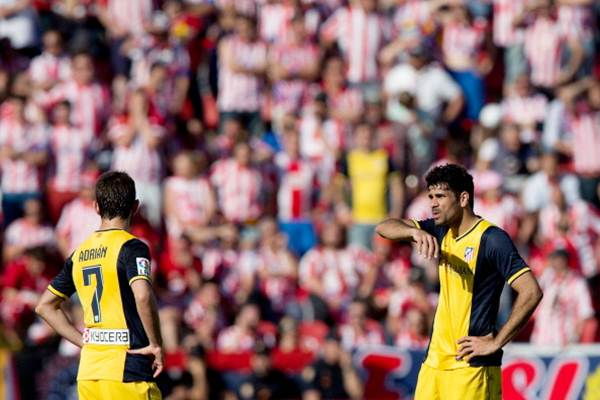 Diego Costa of Atletico de Madrid (right) reacts with teammate Adrian Lopez (left) after Levante's second goal