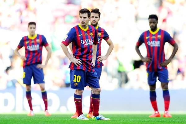 Lionel Messi (centre) and the Barcelona players shows their dejection after Angel Latifa scores Getafe's second goal