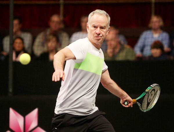 John McEnroe plays a forehand during the singles final against Mats Wilander of Sweden on Day Five of the Statoil Masters Tennis at the Royal Albert Hall on December 08, 2013 in London