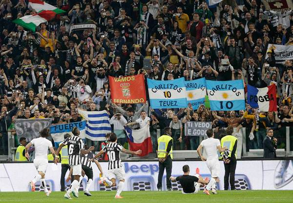 Juventus' players celebrate after winning the Serie A championship at the end of their match against Atalanta at the Juventus stadium in Turin