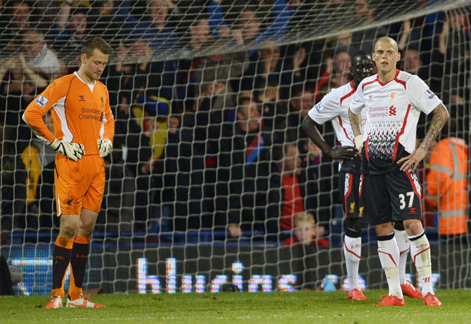 Liverpool players react after Crystal Palace score an equalising goal