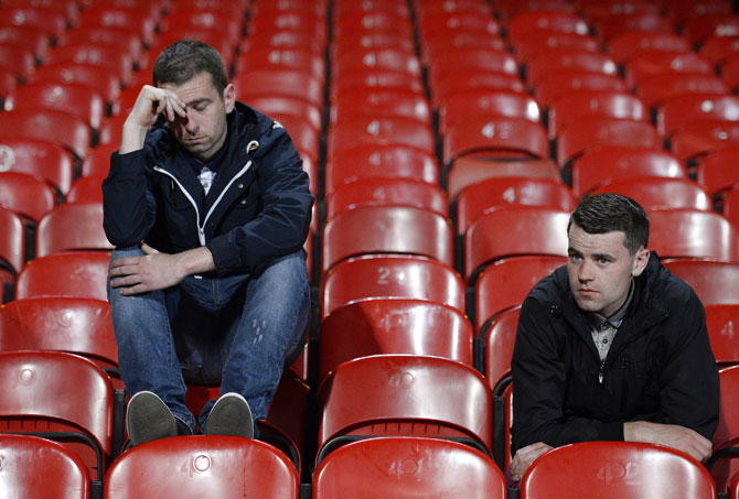 Liverpool fans react following their match against Crystal Palace