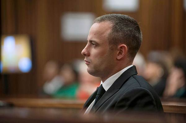 Oscar Pistorius sits in the dock in the North Gauteng high court in Pretoria