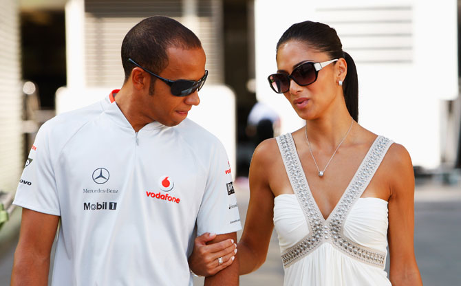 Lewis Hamilton of Great Britain and McLaren Mercedes and his girlfriend Nicole Scherzinger