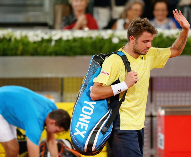 Stanislas Wawrinka of Switzerland walks off court after his three set defeat against Dominic Thiem of Austria