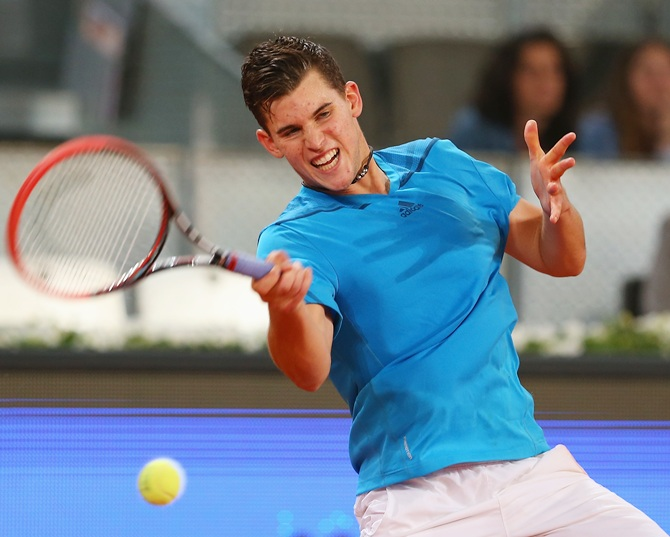 Dominic Thiem of Austria plays a forehand against Stanislas Wawrinka