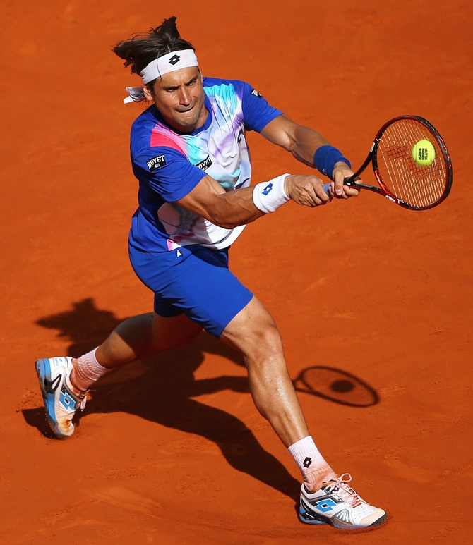 David Ferrer of Spain in action against Albert Ramos