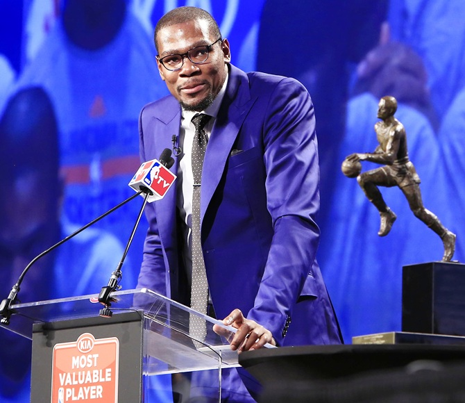 Oklahoma City Thunder player Kevin Durant speaks after receiving the MVP trophy