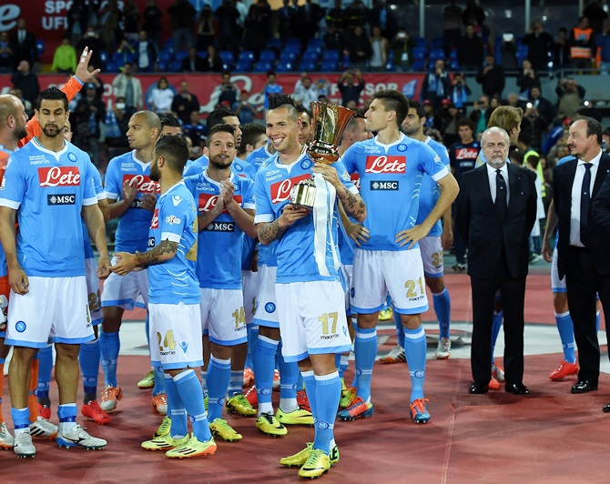 Marek Hamsik of Napoli poses with the Tim Cup next to his team-mates