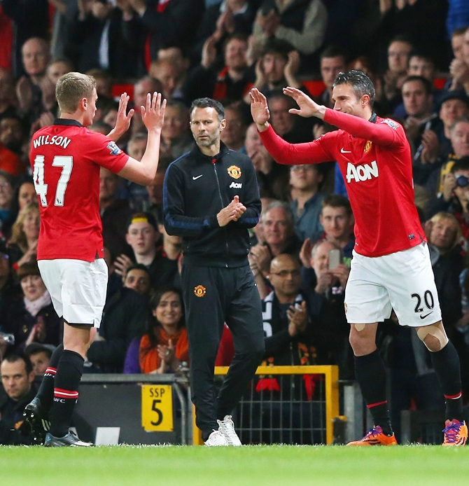 Manchester United Caretaker Manager Ryan Giggs looks on as James Wilson is substituted for Robin van Persie