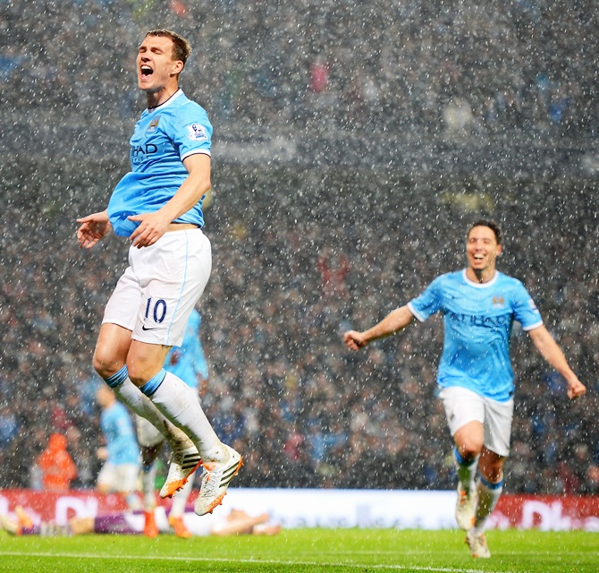 Edin Dzeko of Manchester City celebrates scoring the opening goal