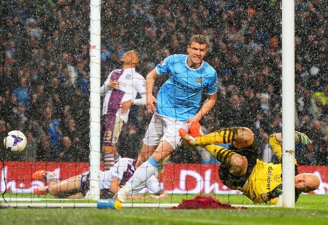 Edin Dzeko of Manchester City celebrates