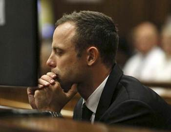South African Olympic and Paralympic athlete Oscar Pistorius sits in the dock during his murder trial in the North Gauteng High Court in Pretoria