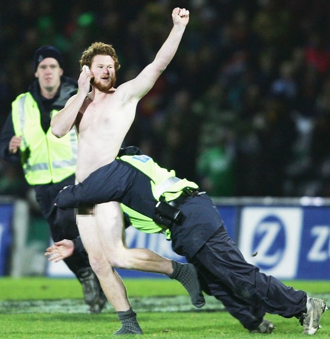 Police tackles a streaker