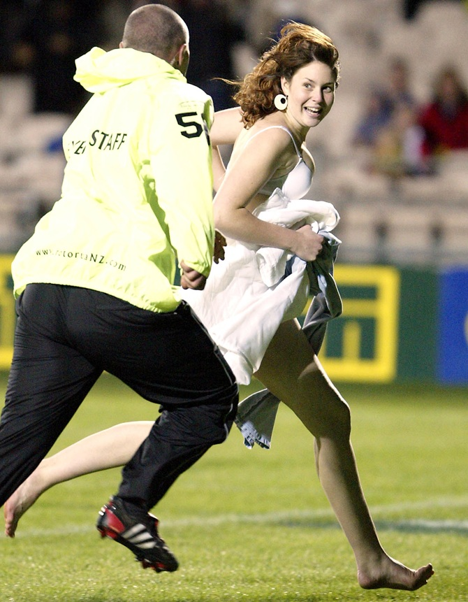 A pitch invader evades police