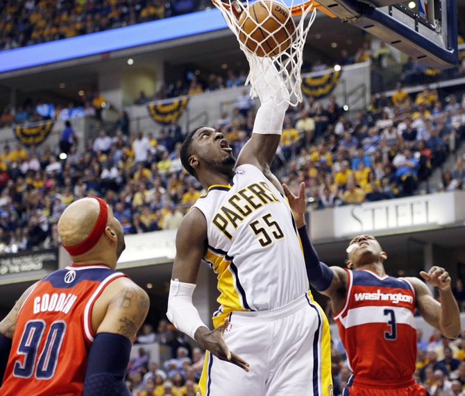 Indiana Pacers center Roy Hibbert (55) dunks against Washington Wizards forward Drew Gooden (90)