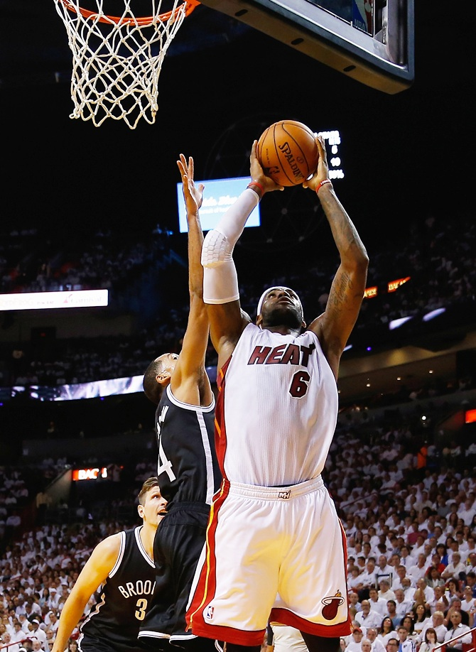 LeBron James (6) of the Miami Heat shoots over Shaun Livingston (14) of the Brooklyn Nets