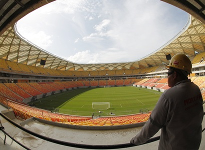 A construction worker looks out over the stadium