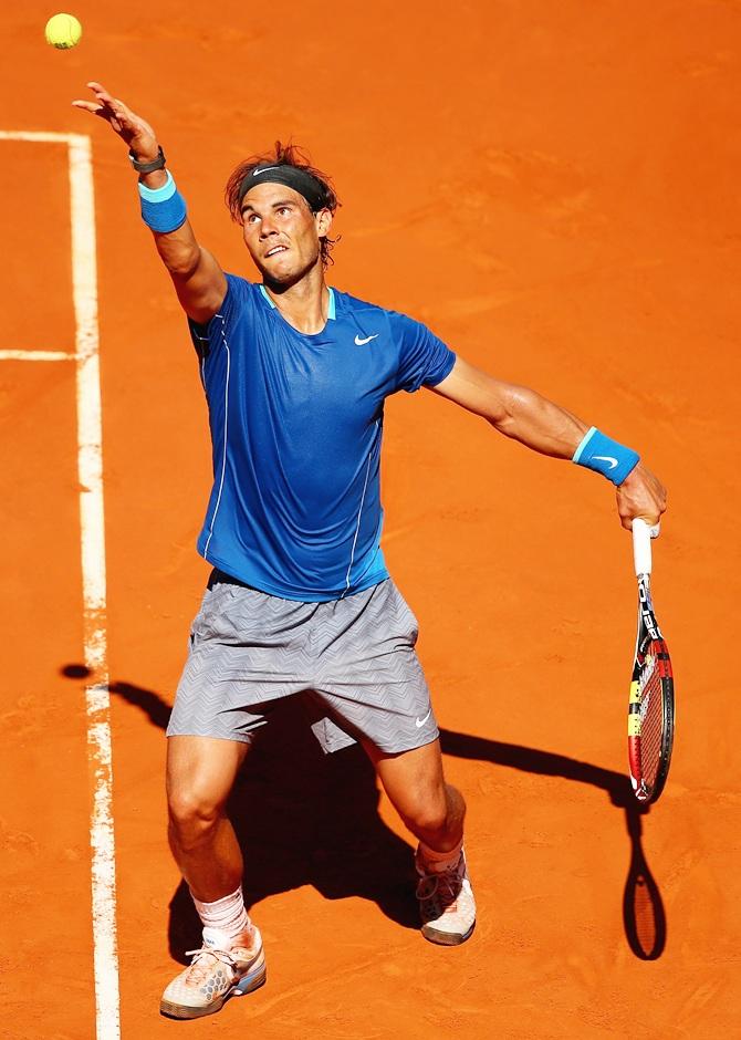 Rafael Nadal of Spain serves