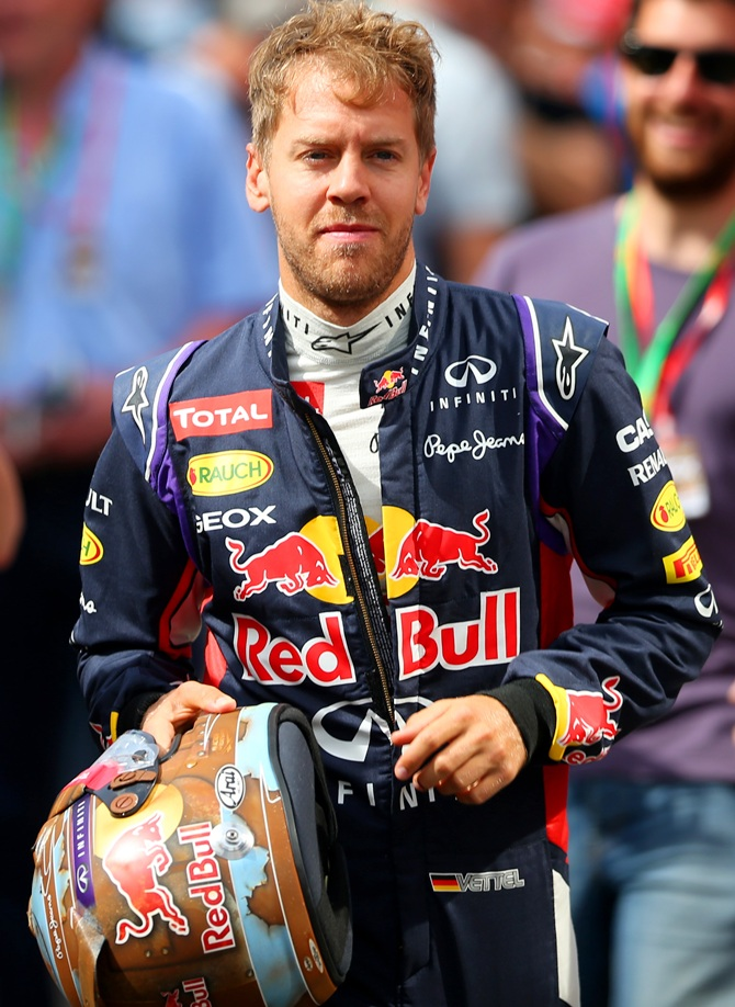 Sebastian Vettel of Germany and Infiniti Red Bull Racing runs to the garage