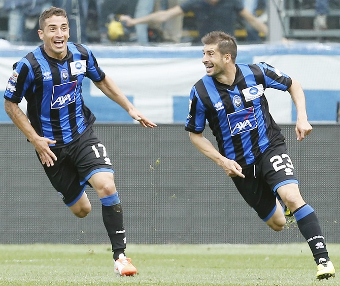 Atalanta's Franco Brienza,right, celebrates with his teammate Carlos Carmona after scoring the team's second goal against AC Milan