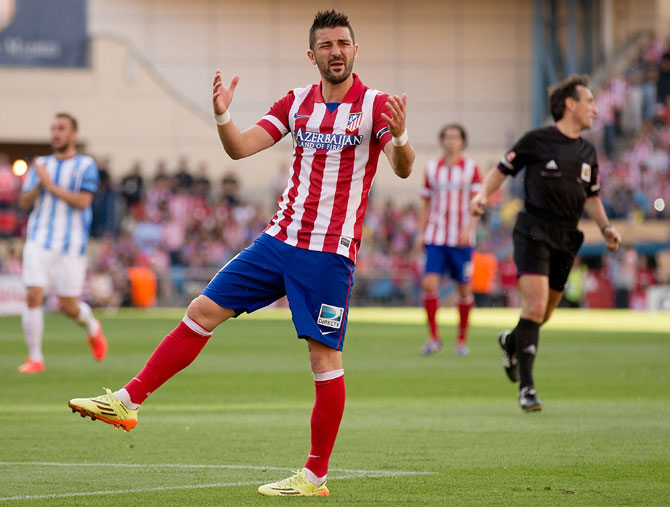 David Villa of Atletico de Madrid reacts as his team fails to score.