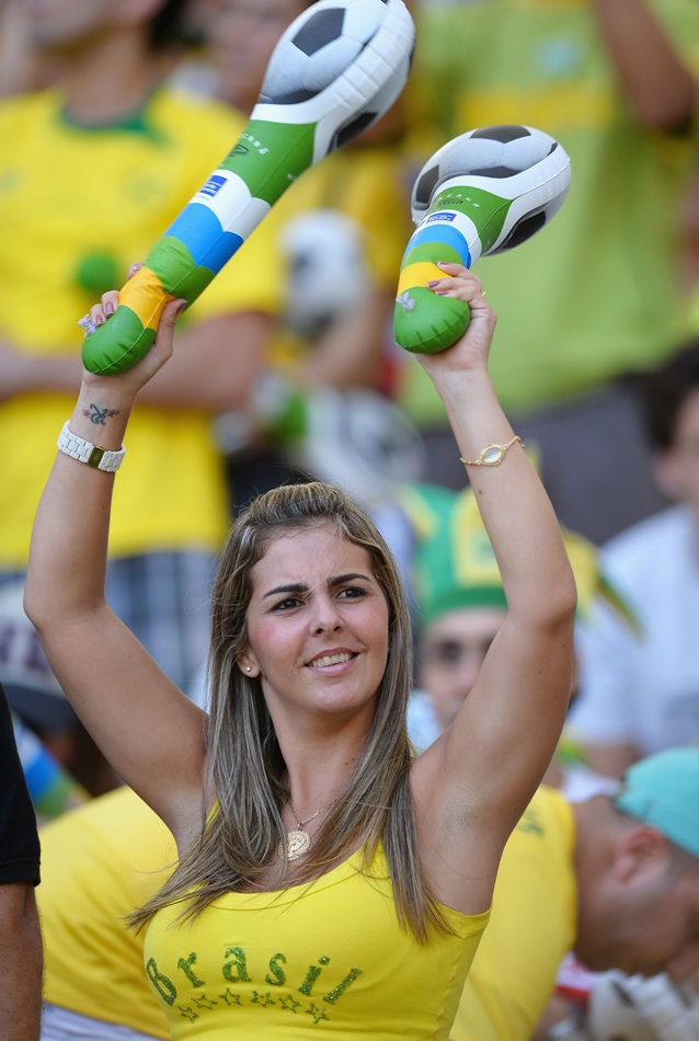 A Brazil fan enjoys the pre-match atmosphere; Neymar