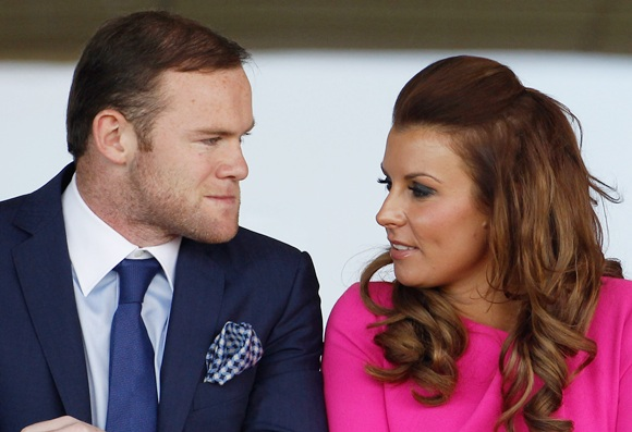 Manchester United football player Wayne Rooney and his wife Coleen watch