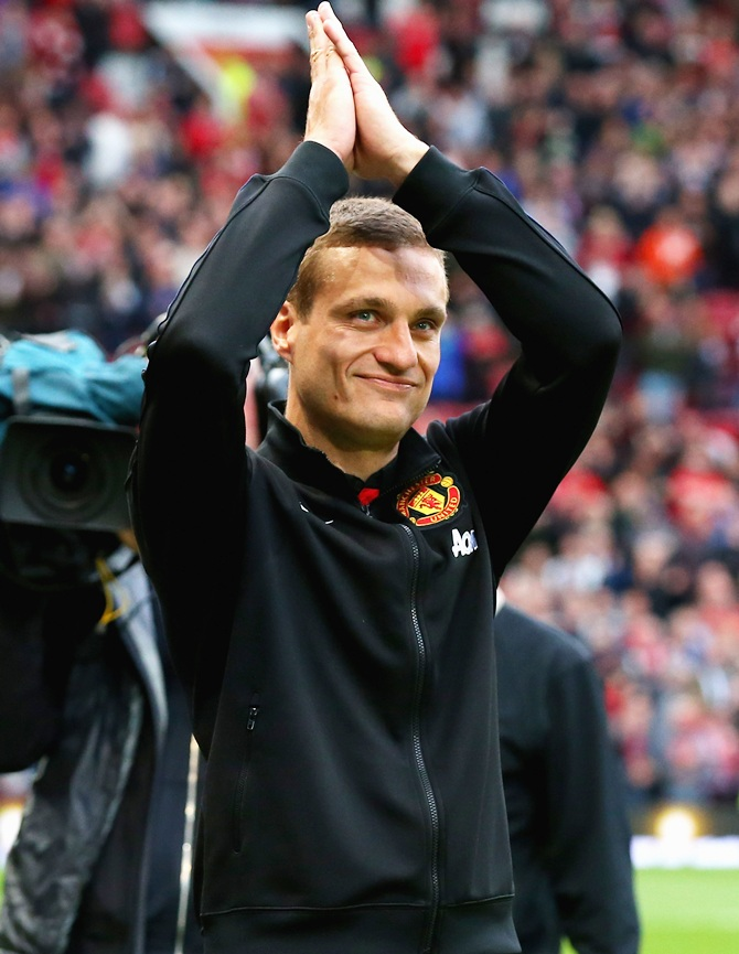 Nemanja Vidic of Manchester United salutes the crowd