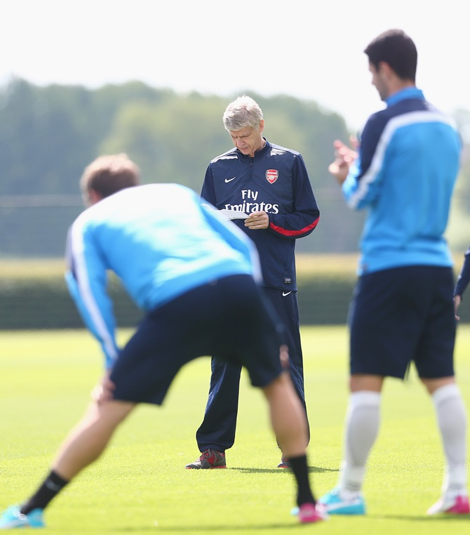 Arsene Wenger of Arsenal looks on during a training session ahead of the FA Cup Final match between Arsenal and Hull City