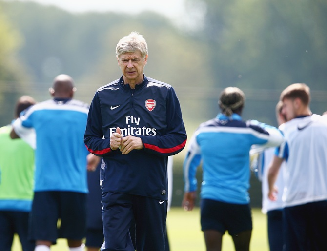 Arsene Wenger of Arsenal looks on during a training session