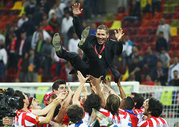 Atletico Madrid Coach Diego Simeone is thrown in the air by his players