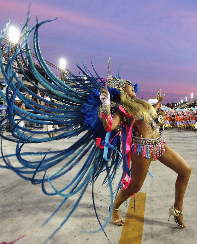 A reveller from the Vila Isabel samba school parades in a stadium