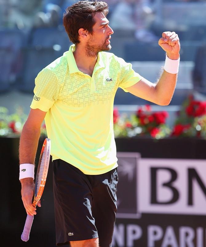 Jeremy Chardy of France celebrates defeating Roger Federer of Switzerland