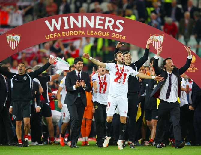 Nicolas Pareja of Sevilla celebrates victory with team mates after the UEFA   Europa League Final match against SL Benfica at Juventus Stadium